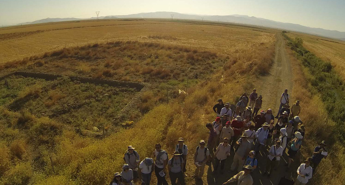 Archaeology researchers in a field in Zincirli, Turkey, photographed from above.