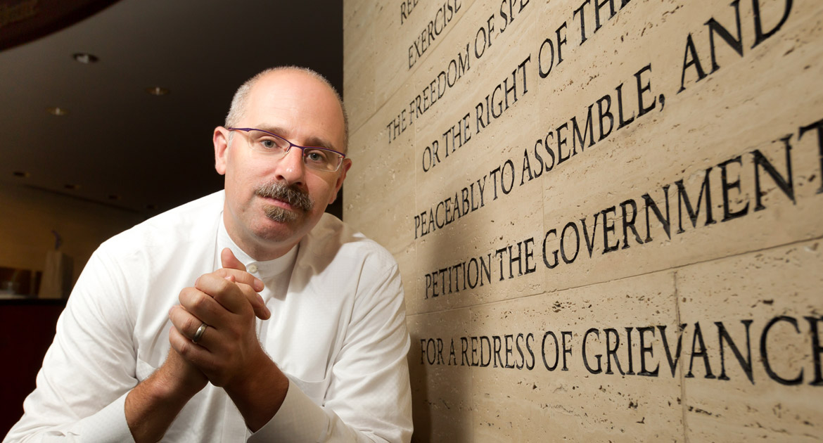 Professor Thomas Ginsburg with stone engraving of US Constitution