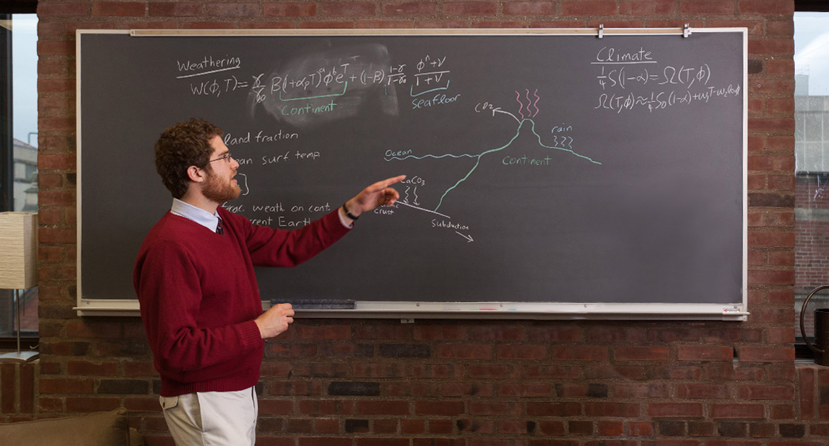 Dorian Abbot explaining diagram on chalkboard.