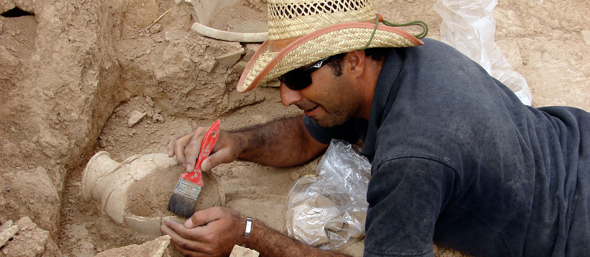 Archaeologist works at on site dig