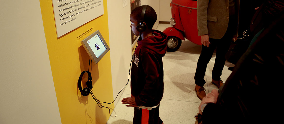 A kid interacts with Smart Museum exhibit