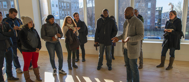Visitors listen during a studio tour