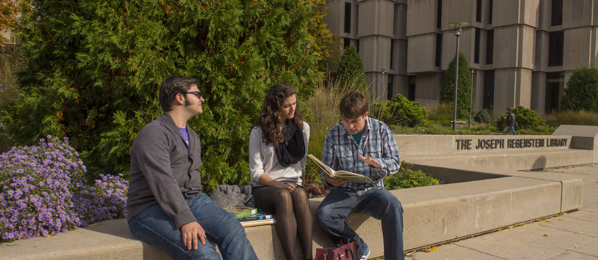 Students sitting outside at Regenstein Library