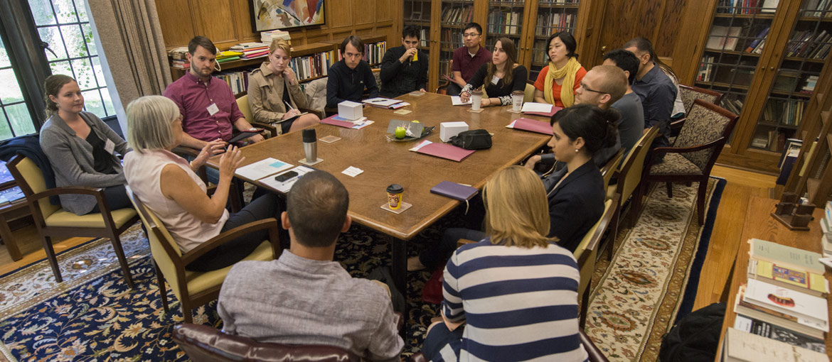 A professor leads a small class of Divinity students