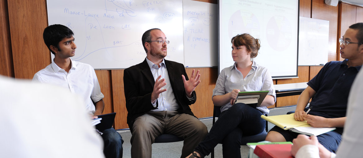 University of Chicago's Harris School Faculty Support and Academic Centers: Ethan Bueno de Mesquita with students