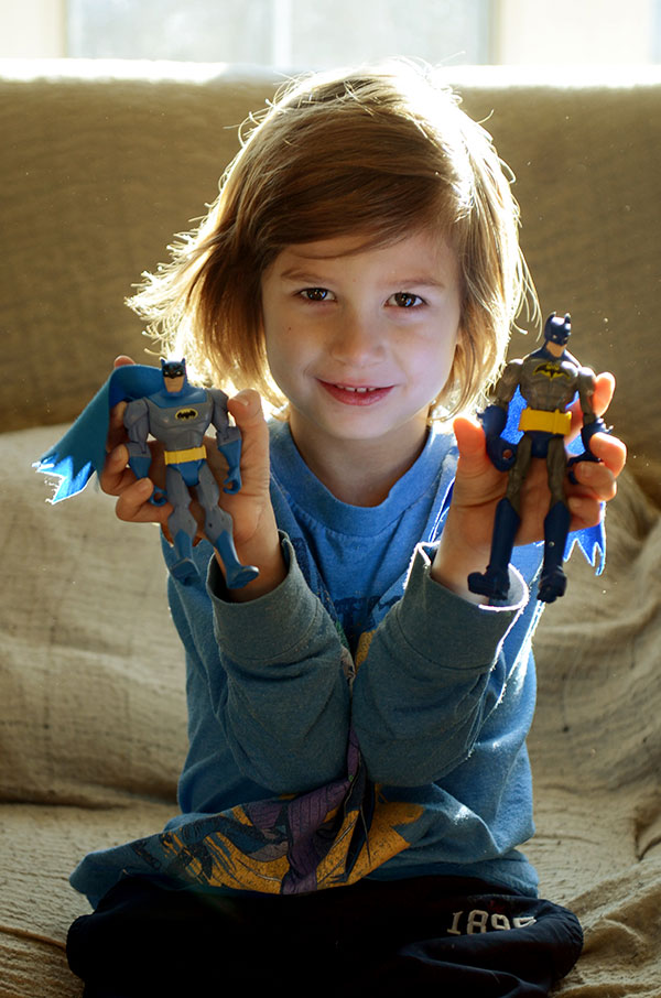Drew holding up two Batman action figures