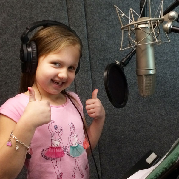 Mya gives a thumbs-up during the taping of a radio ad for Comer Children's Hospital