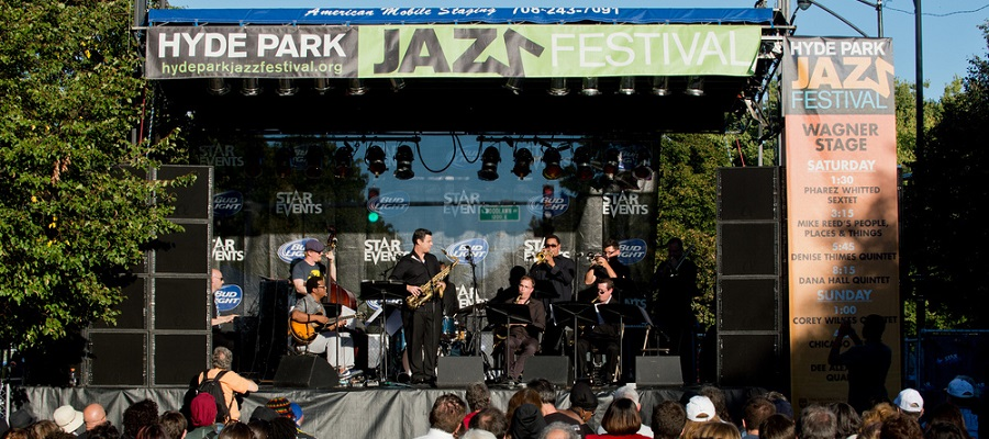 Band plays in front of crowd at Jazz Festival.
