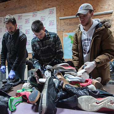 clothing donations being sorted