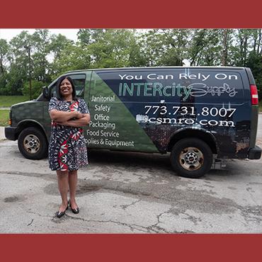 Woman business proprietor in front of her van at UChicago campus