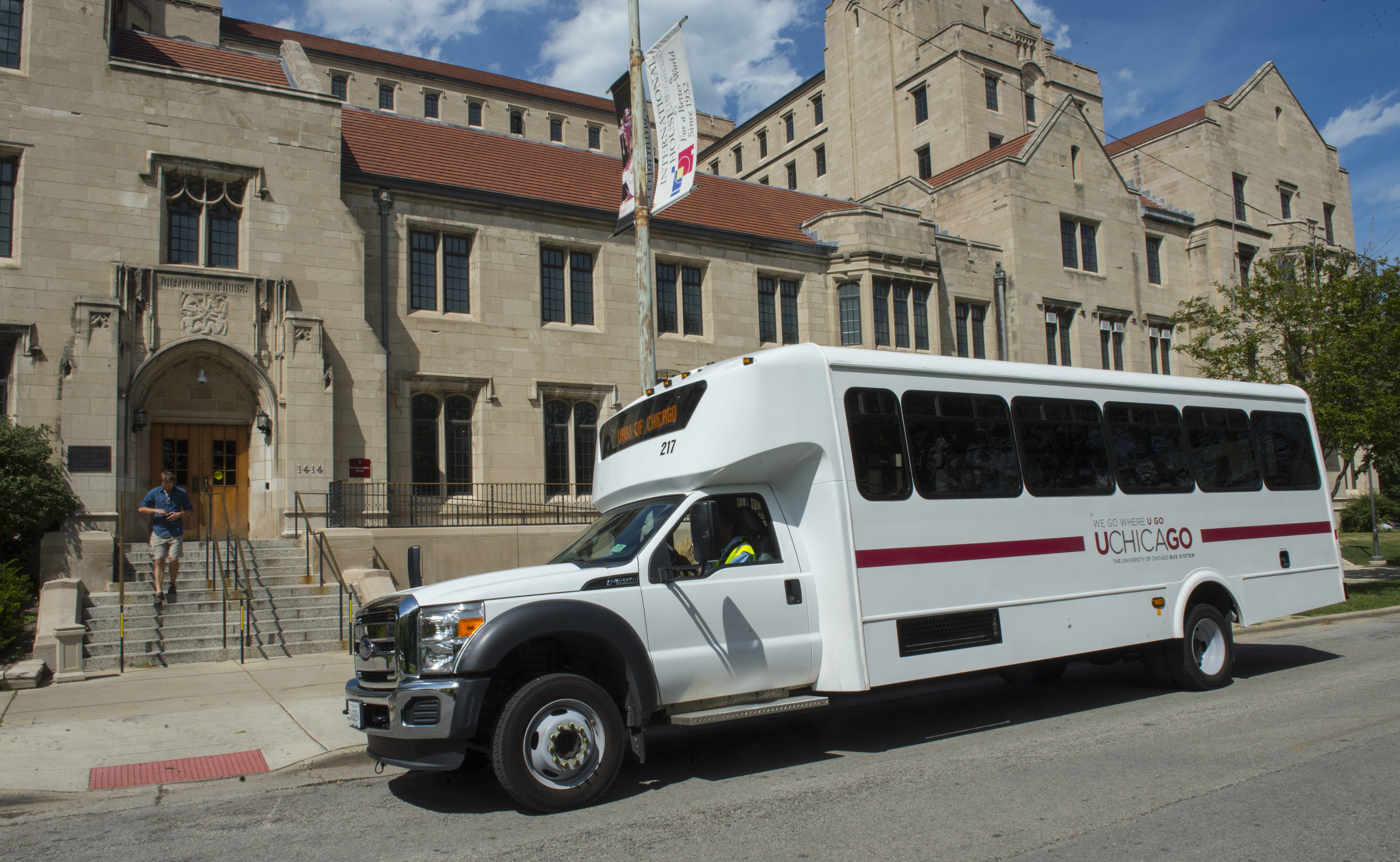 A UGo shuttle waits outside of the University's International House.