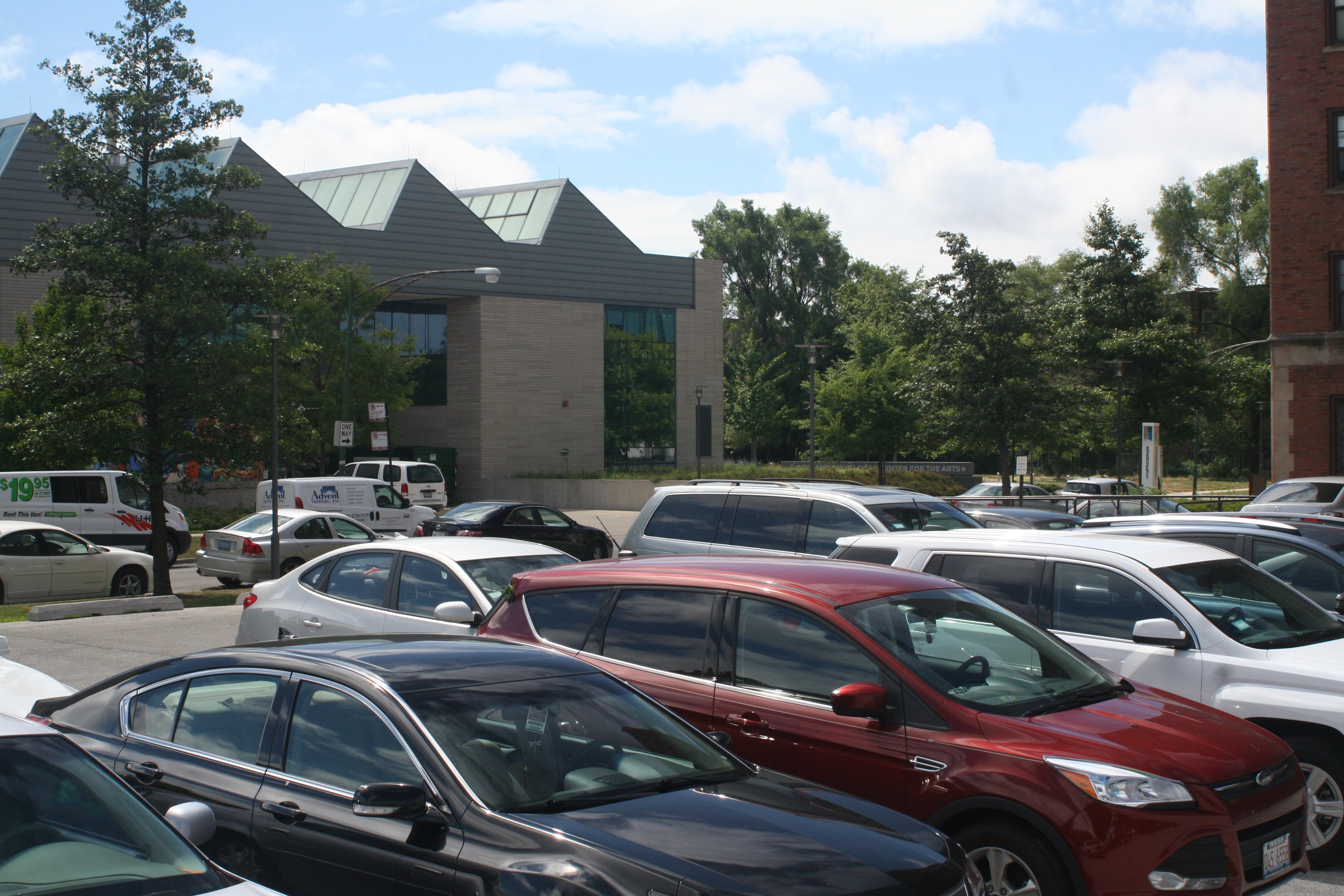 Cars parked in the Wells parking lot on south campus.