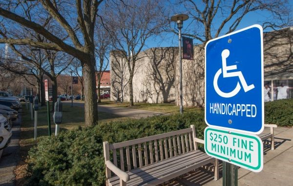 A sign showing where an accessible parking spot is on campus.
