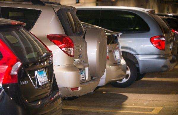 Several cars parked in Ellis Garage.