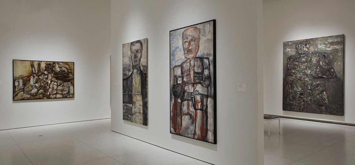 Installation view of Monster Roster, showing paintings by Fred Berger (far left) and Leon Golub