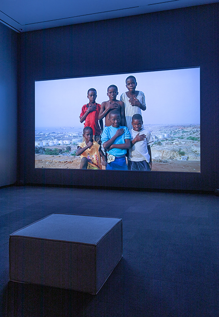 Alfred Jaar's video Muxima in a black box room at the Smart Museum