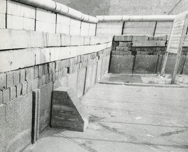 Wolf Vostell, Untitled [Betonstuhl during the Happening Desastres at the Berlin Wall], 1972. Photo by Jürgen Müller-Schneck. Art © The Wolf Vostell Estate.