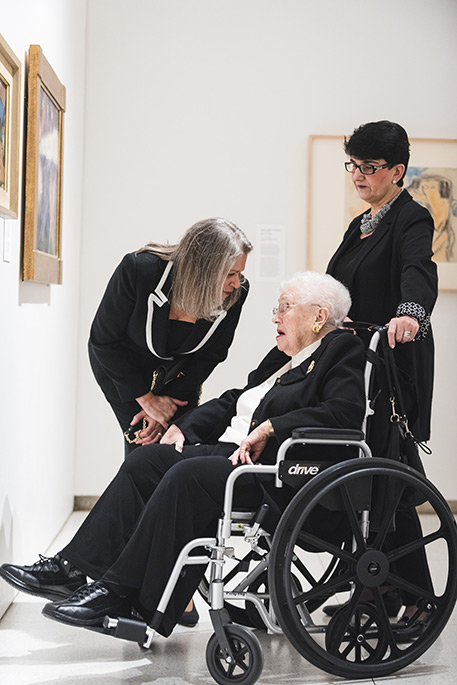 A wheelchair user visits the Smart Museum's galleries