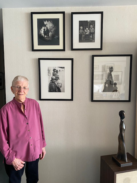 Janis Mendelsohn next to some of the photographs in her collection.
