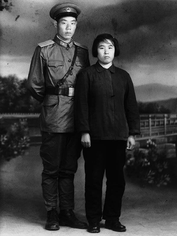 A young man and woman stand together
