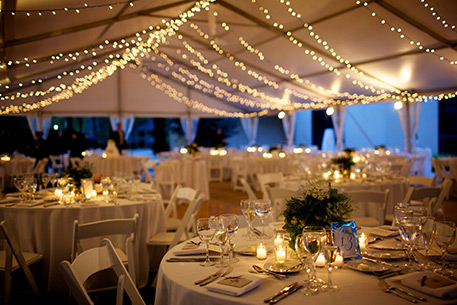 Tented courtyard decorated for wedding reception