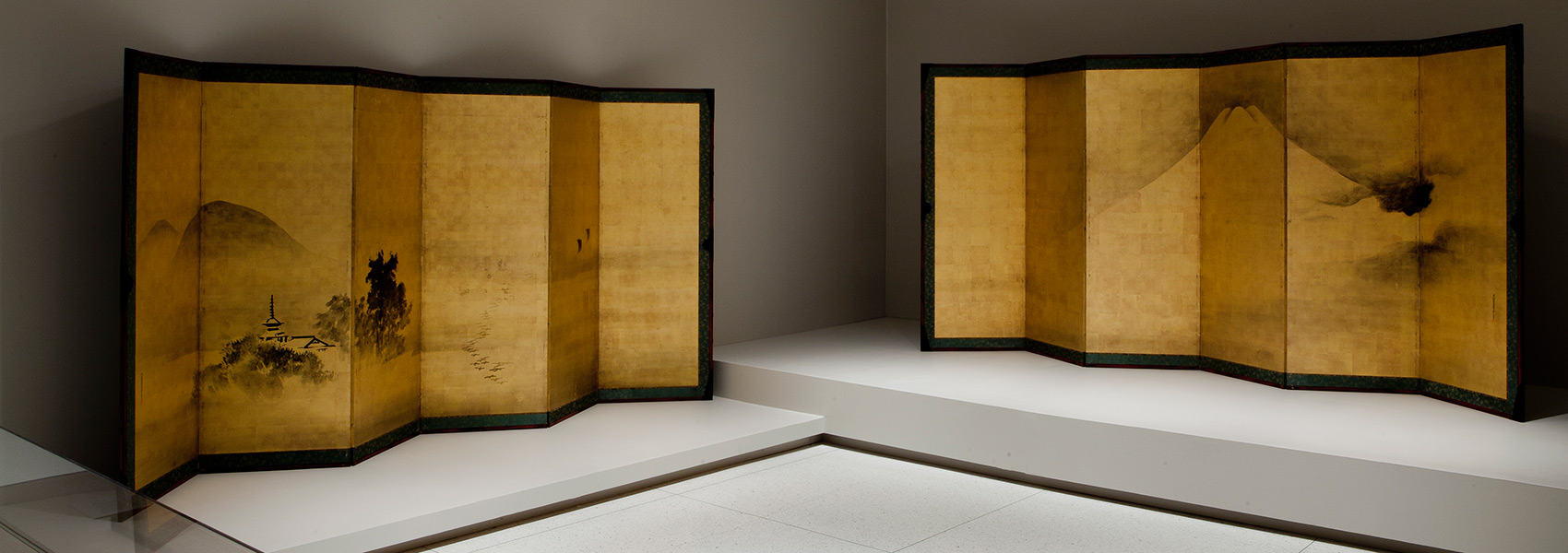 Installation view of Objects and Voices showing two screen paintings attributed to Tosa Mitsunari