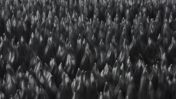 Rows of flame-like black porcelain sculptures