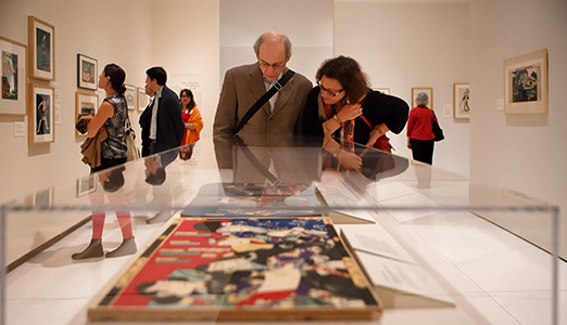 Visitors looking at art in Awash in Color