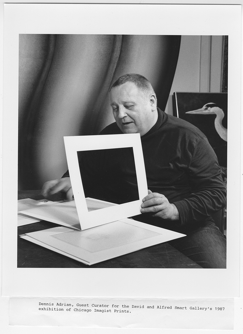 Photo of Dennis Adrian, curator of The Chicago Imagist Print, looking at prints at a desk, 1987