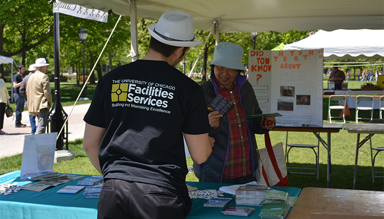 Office of Sustainability intern Freddy Izguerra greets a visitor to at the 6th annual Earth Fest held on the Main Quadrangles in late May. This year's theme centered on local foods.