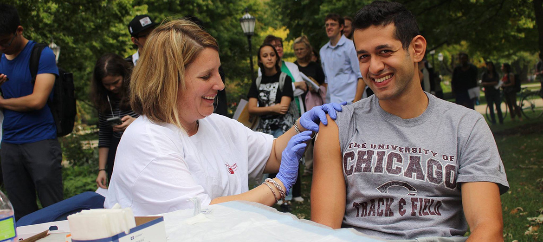Student receiving flu shot at Wellapalooza.