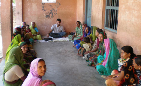 Taparia at work in the field for SKS Microfinance.