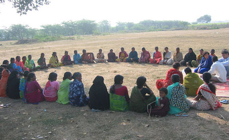 Borrowers gather for a weekly meeting in the village of Chatyal.