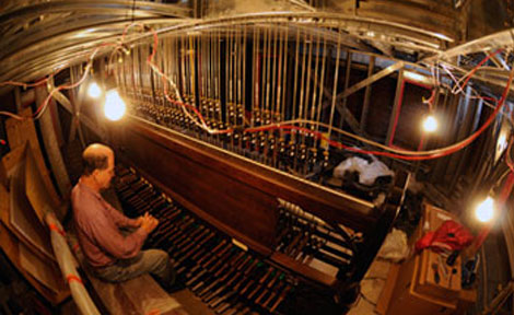 University Carillonneur Wylie Crawford playing during construction of the carillon.