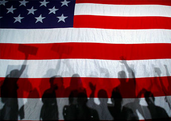 Supporters cast shadows on a U.S. flag.