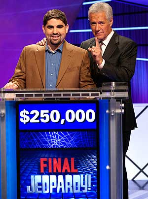 Dan Pawson, JD'06, with host Alex Trebek after winning the 2009 Jeopardy! Tournament of Champions in Las Vegas.