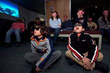 Children take in a 3D view of the universe at Adler Planetarium's Space Visualization Lab