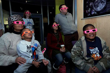 Visitors explore the universe and recent research data at the Adler Planetarium