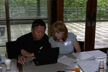 Evalyn Gates, Assistant Director of the Kavli Institute for Cosmological Physics, works with Curtis Wong, Principal Research Software Design Engineer, Microsoft Next Media Research, in the World Wide Telescope/Google Sky Workshop, held on the University o