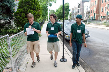 Zachary DeWalt, Evan Babb, and Clifford Hunt canvass the neighborhood.