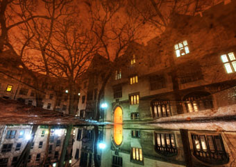 Photograph of a reflection in the main quads of the University of Chicago
