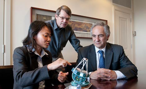 Hsiao-Wen Chen, Assistant Professor in Astronomy & Astrophysics, points out a feature on a model of the Giant Magellan Telescope to President Robert J. Zimmer (right), and Richard Kron, Professor in Astronomy & Astrophysics.