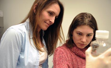Erin Adams (left), Assistant Professor in Biochemistry & Molecular Biology