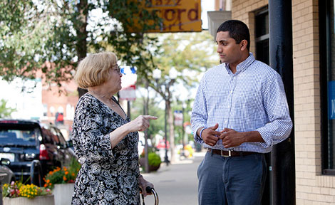 Ameya Pawar talks to a constituent