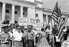 President Dwight D. Eisenhower orders federal troops to enforce integration of schools in Little Rock, Ark.