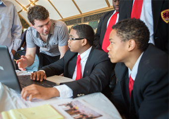 Ted Gonder (left) speaks with students from Gary Comer College Prep.