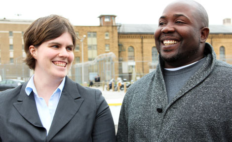 Tara Thompson, JD'03, staff attorney with the Exoneration Project, speaks with James Harden