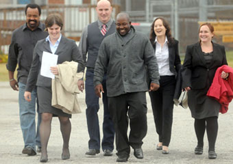 James Harden (center) walks with members of his legal team