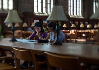 Two students studying in Harper Memorial Library