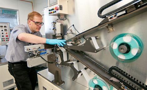 Argonne engineer Andrew Jansen  making a prototype lithium-ion battery